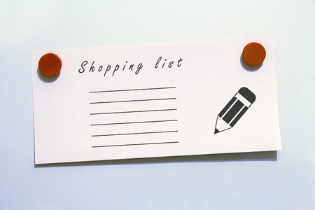 magnets: Shopping list with magnets, white background
