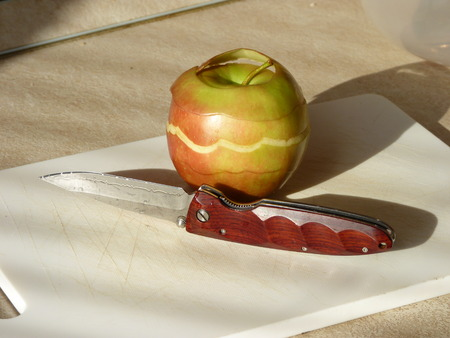 carbonaceous: Penknife with a blade from Damask steel Stock Photo