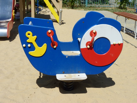 children's: Children s swing in the form of a ship at a playground in the city of Volgograd