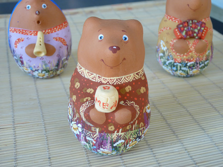 The Russian clay souvenir toy the Bear with a honey pot  an inscription  honey      photo