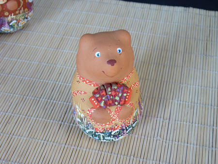 The Russian clay souvenir toy the Bear with an accordion photo