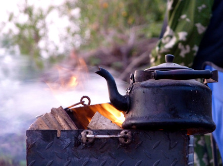 the Teapot on a brazier on picnic photo