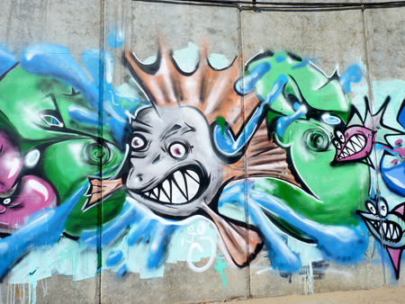 graffiti Toothy fish on embankment walls in the city of Volgograd