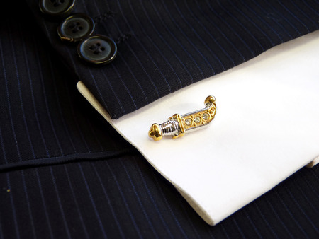 Cuff link for a cuff on a shirt in the form of an ancient knife photo