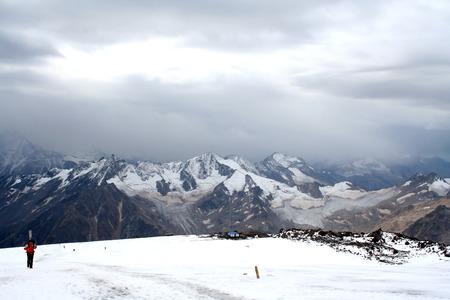 elbrus: Ice slope of Mount Elbrus against the Big Caucasian spine Editorial