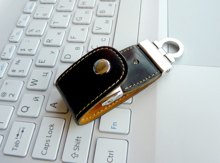 The elite store of memory in leather cover on the laptop keyboard