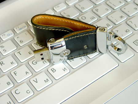 elite: The elite store of memory in leather cover on the laptop keyboard