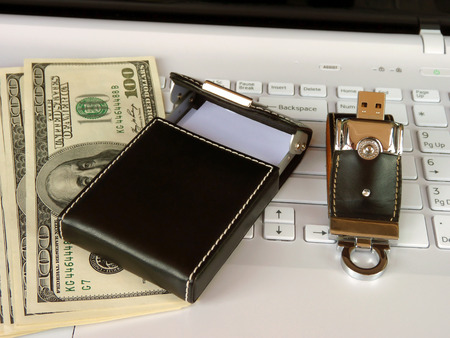 elite: The elite store of memory and card holder  in leather cover on the laptop keyboard Stock Photo
