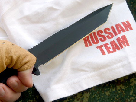 chrome molybdenum: Knife hunting tourist with a black blade of the Russian production Stock Photo