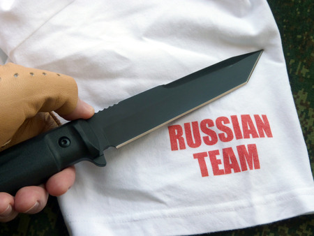 Knife hunting tourist with a black blade of the Russian production Stock Photo