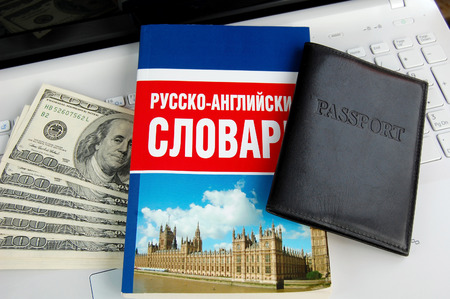 For preparation for travel: the Russian-English dictionary, the passport, money, a reservation via the computer photo