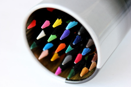 etude: Set of colored pencils for drawing in the round box