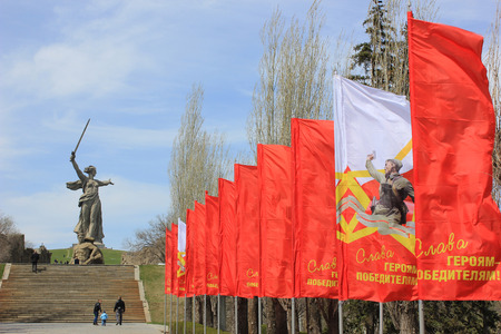 Festive flags with an inscription Glory to conquering heroes on Mamayev Kurgan in Volgograd Editorial