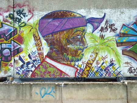 suntanned: Graffiti the Suntanned person on a concrete wall in the city of Volgograd