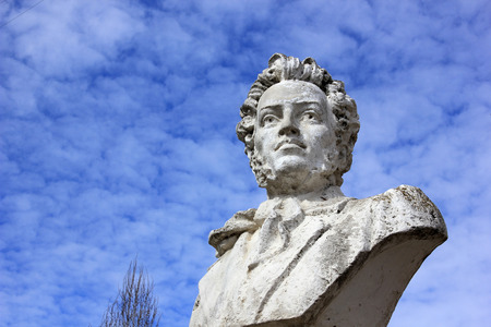 prose: Bust of the Russian poet Pushkin in the yard at the building of high school in the city of Volgograd