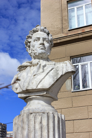 city pushkin: Bust of the Russian poet Pushkin in the yard at the building of high school in the city of Volgograd