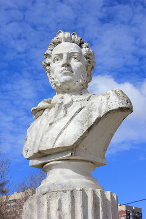national poet: Bust of the Russian poet Pushkin in the yard at the building of high school in the city of Volgograd