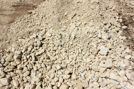 emptiness: Yellow gravel for laying of asphalt roads and filling of emptiness