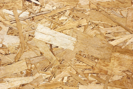remains: Surface of the pressed woodshaving plate made of the remains of processing of a tree
