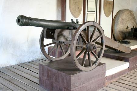 serf: Ancient gun in the serf castle in Slovakia