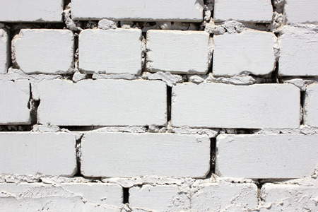 beige background: House wall element from the brick painted in white color