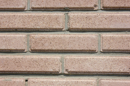 beige background: House wall element from a brown brick