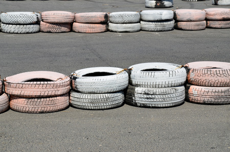 validez: Painted tires as chippers, on the autodrome for karting.