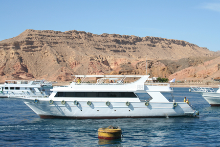 tour operator: The powerboat in the Red Sea against small mountains of the Sinai Peninsula Stock Photo