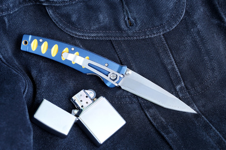 Penknife with a blade from Damask steel with a petrol lighter