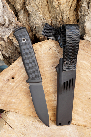 chrome molybdenum: Knife hunting tourist with a black blade and a plastic cover