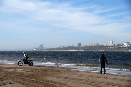 strong wind: Training on cross-country race on the bank of Volga at a strong wind Stock Photo