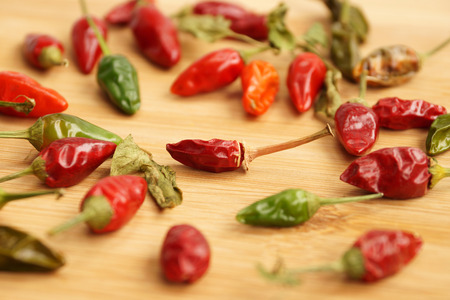 product range: Scattering of burning small pepper on a chopping board