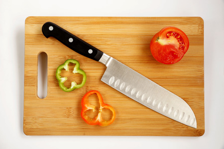 carbonaceous: Knife cook universal with a blade like Santoku on a chopping board