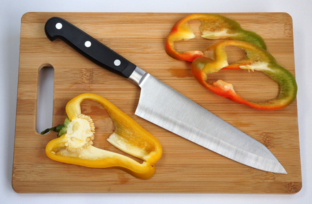 carbonaceous: Knife cook universal on a chopping board