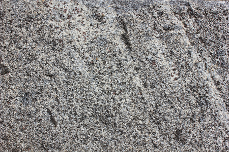 Monolith: Monolith surface from the gray natural processed granite Stock Photo