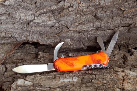 multipurpose: Folding multipurpose knife with the plastic handle Stock Photo