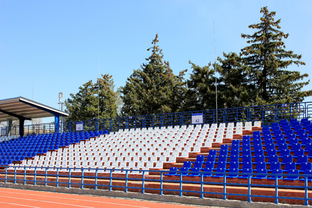 tribune: Tribune with chairs at small old stadium