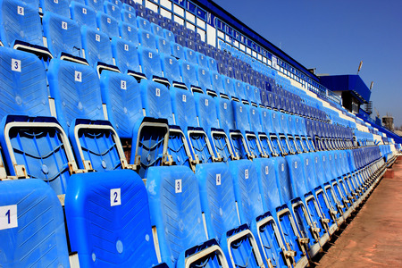 tribune: Tribune with folding chairs at small old stadium Stock Photo