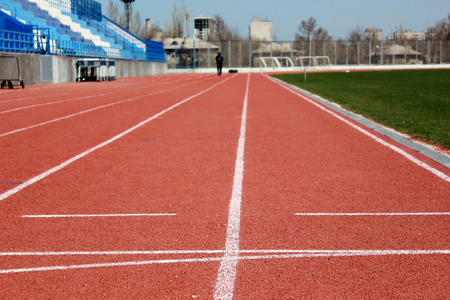 etude: Rubber racetrack at old small stadium