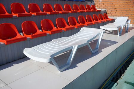 chaise lounge: Chaise lounge for fire about tribunes of the swimming pool