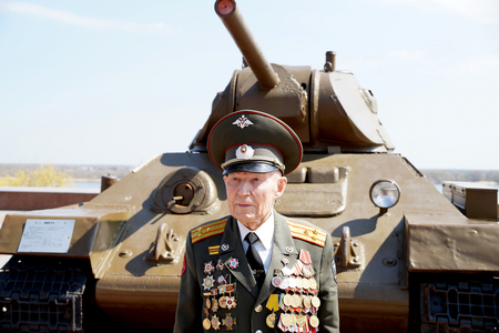 t34: Defender of Stalingrad veteran of World War II colonel Vladimir Semenovich Turov at the T-34 tank