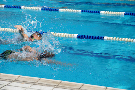 rival rivals rivalry season: Heat of children on one path in the swimming pool