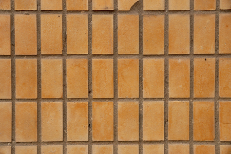 facing a wall: Beige facing tile on a house wall Stock Photo