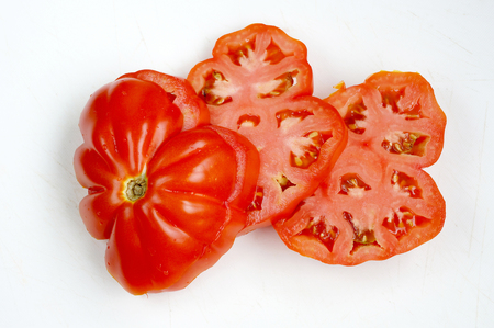 Red tomato of the big size of a grade of Puzata Hata