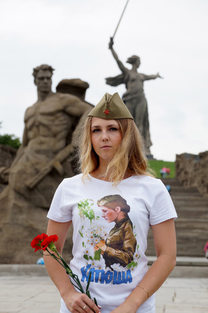 garrison: Girl in a garrison cap and in a t-shirt with the name Katyusha on Mamayev Kurgan Stock Photo