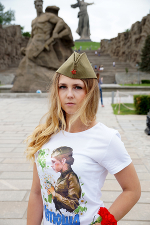Girl in a garrison cap and in a t-shirt with the name Katyusha on Mamayev Kurgan Stock Photo