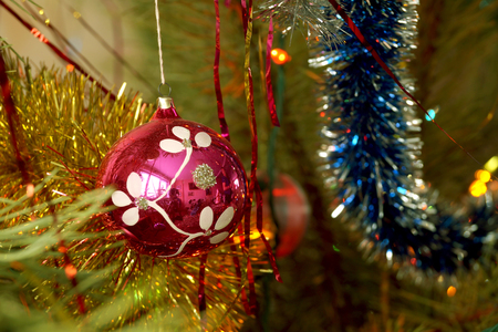 trade off: Fir-tree toy a plastic sphere with the drawn snowflake Stock Photo