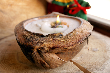 Santa Claus and a candle in a decorative coconut Stock Photo