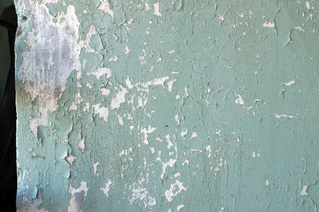peeledoff: House wall fragment with the peeled-off old paint