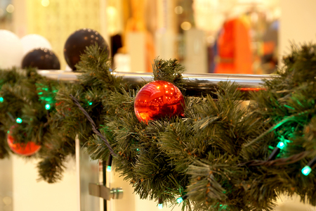 Christmas decoration of shopping center spheres, bows and branches of a fir-tree Banco de Imagens